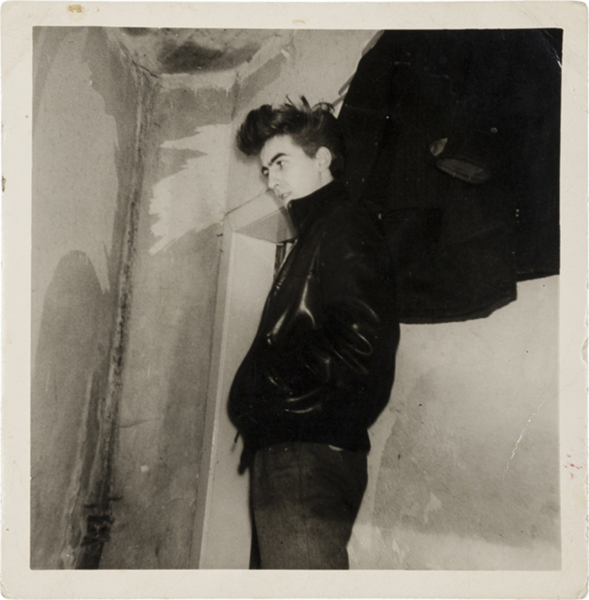 A vintage snapshot of 17-year-old George Harrison modeling his first leather jacket, taken in 1960 in Hamburg shortly before his deportation from Germany for being underage (est. $3,000+). Image courtesy of Heritage Auctions.