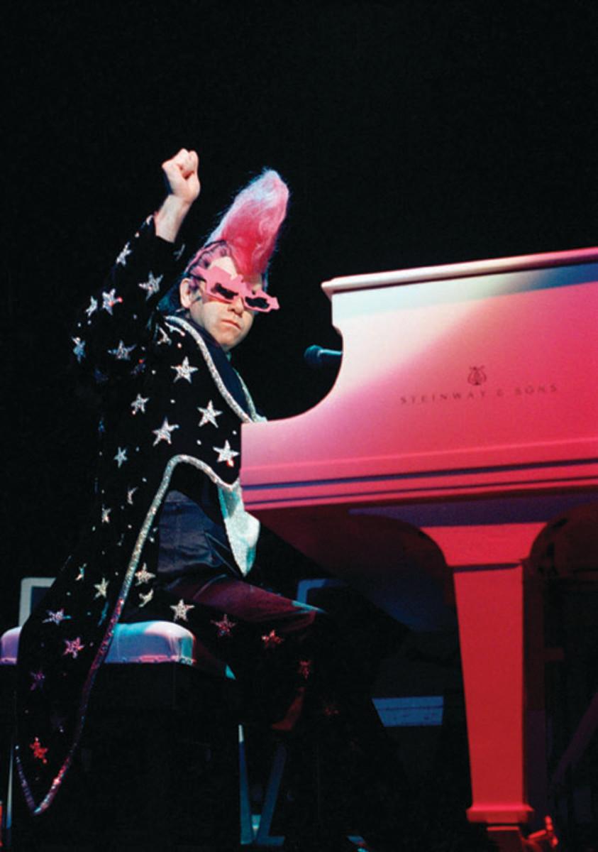 Elton strikes a glamorous pose at his piano. AP photo