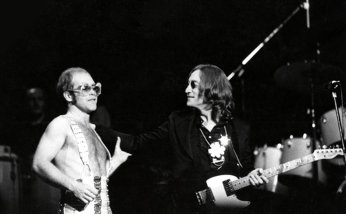 JOHN LENNON joins Elton John onstage at Madison Square Garden, New York City, Nov. 28, 1974. Photo by Steve Morley/Redferns/Getty Images