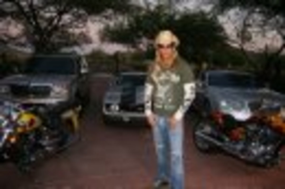 bret in front of cars promo pic