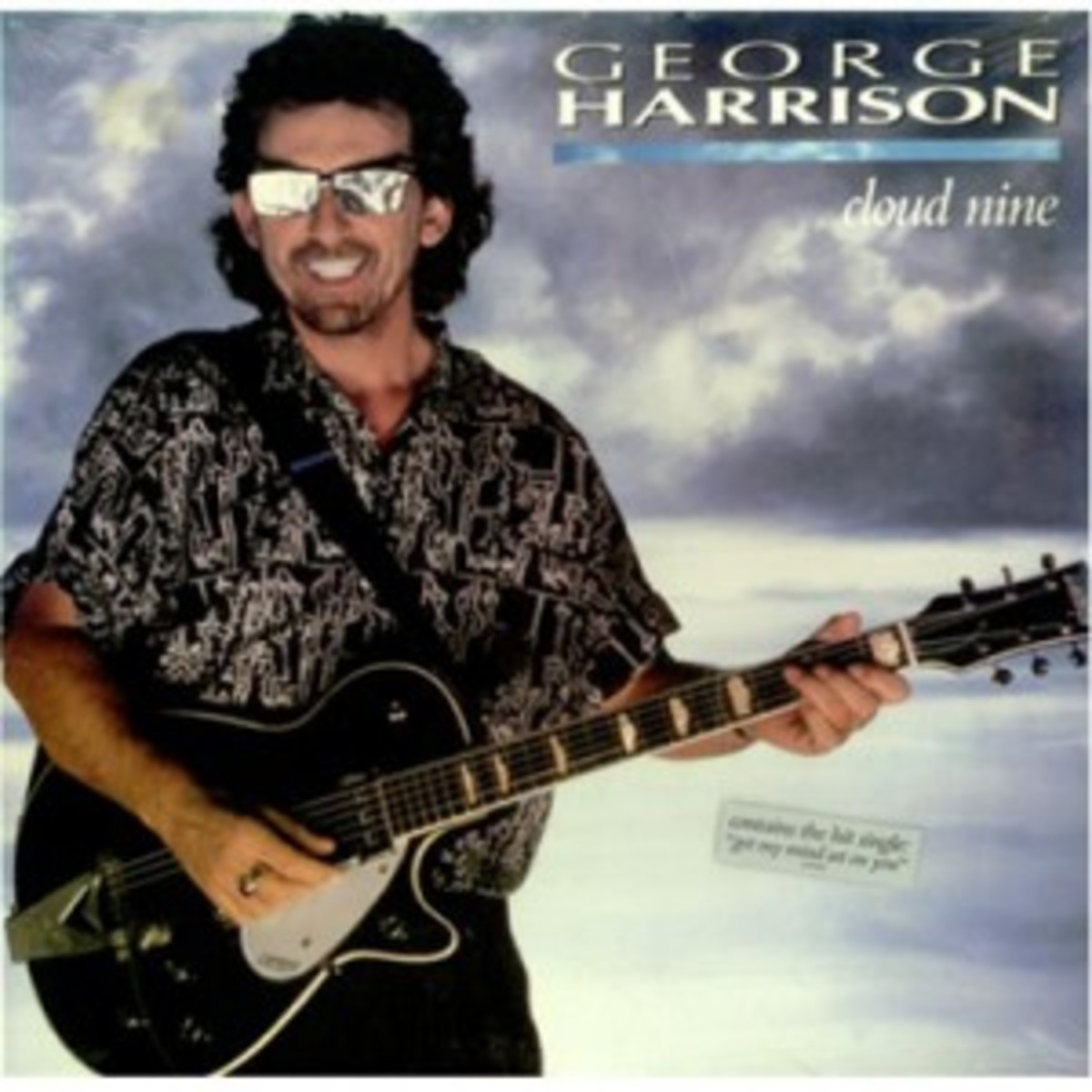 george-harrison-cloud-nine-seal-422480
