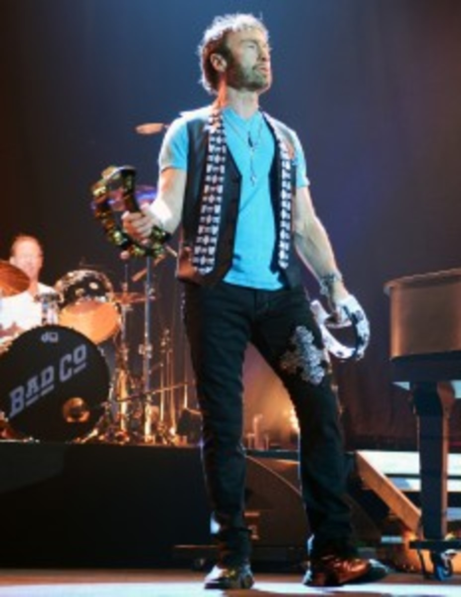Paul Rodgers adds percussion to Simon Kirke's firm backbeat. (Photo by Chris M. Junior)
