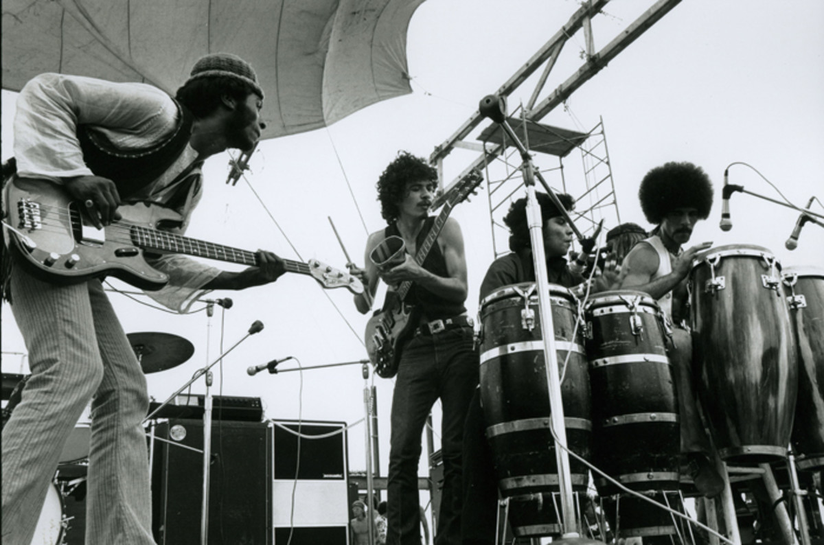 Santana performing at Woodstock in August 1969. Photo by Jason Laure, courtesy of Frank White Photo Agency.