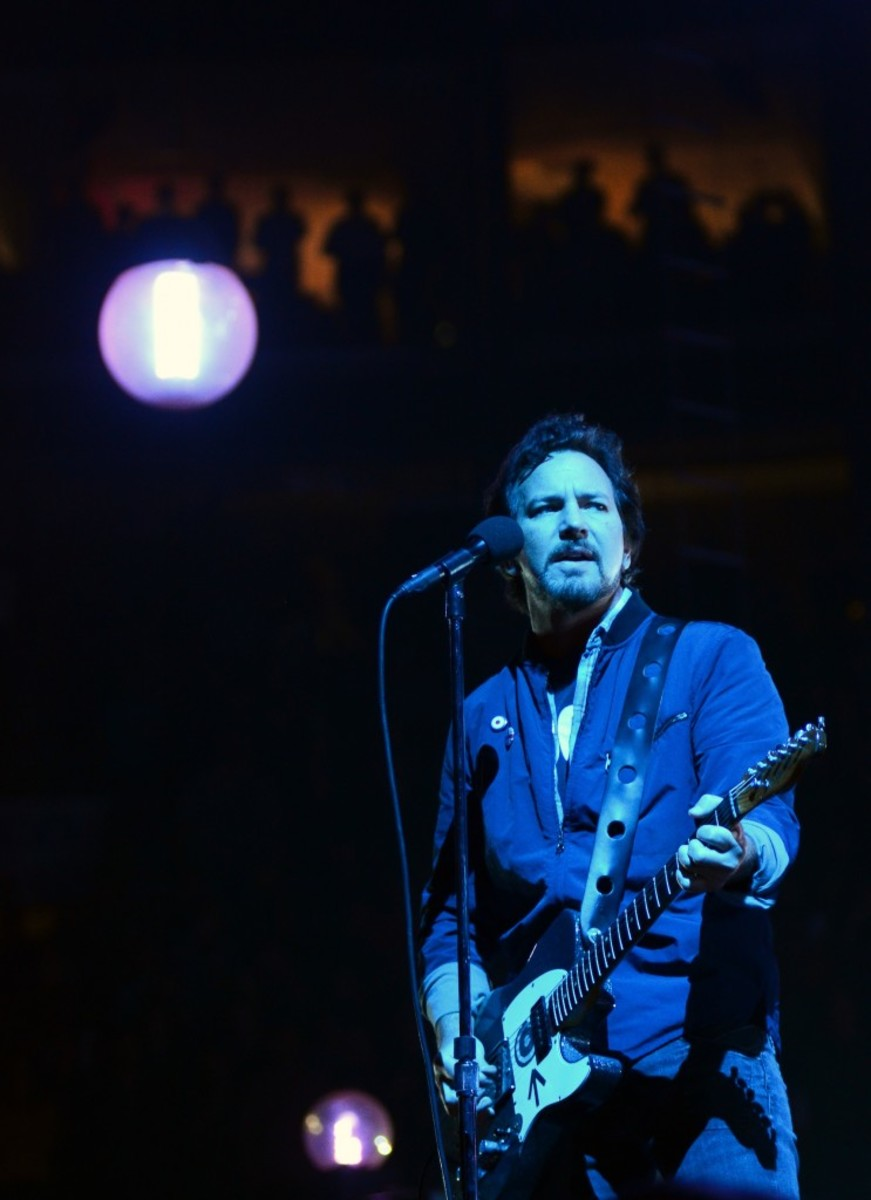 When Eddie Vedder wasn't playing guitar, the singer was working the Wells Fargo Center stage, standing atop monitors and, at one point, swinging from one of the lights. (Photo by Chris M. Junior)
