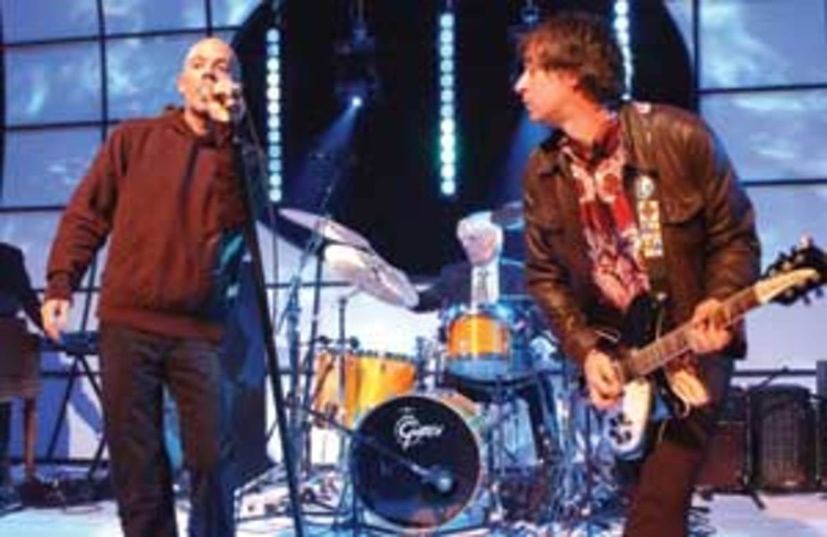 "R.E.M. appearS on the television show ""Top of the Pops"" at BBC TV Studios in London, Wednesday, Oct. 15, 2003. (AP Photo/Mark Allan)"