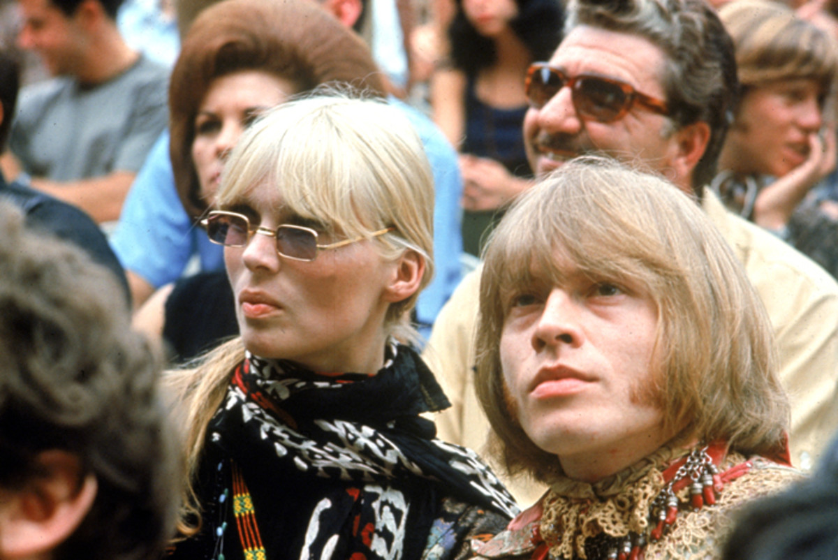 German model and singer Nico of the Velvet Underground and Brian Jones of The Rolling Stones sit in the audience at the Monterey International Pop Festival, Monterey California, 1967. Photo by Fotos International/Getty Images