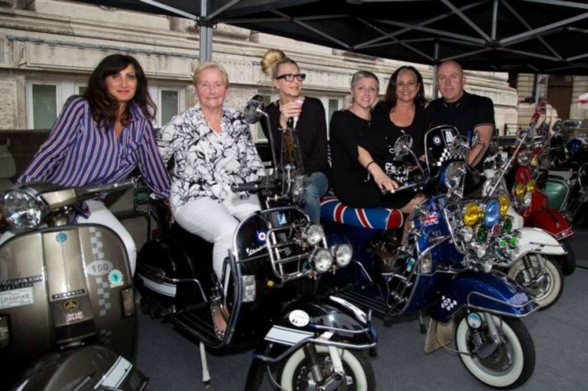 Den Davis, co-curator of The Jam's About The Young Idea exhibition in Liverpool who has done a Q&A with GOLDMINE regarding the exhibition, is shown at far right in this photo taken outside the exhibition along with co-curator Nicky Weller (third from right) and Ann Weller (second from left), who is the mother of Paul and Nicky Weller. (Photo by Dean Fardell for Nicetime Productions)