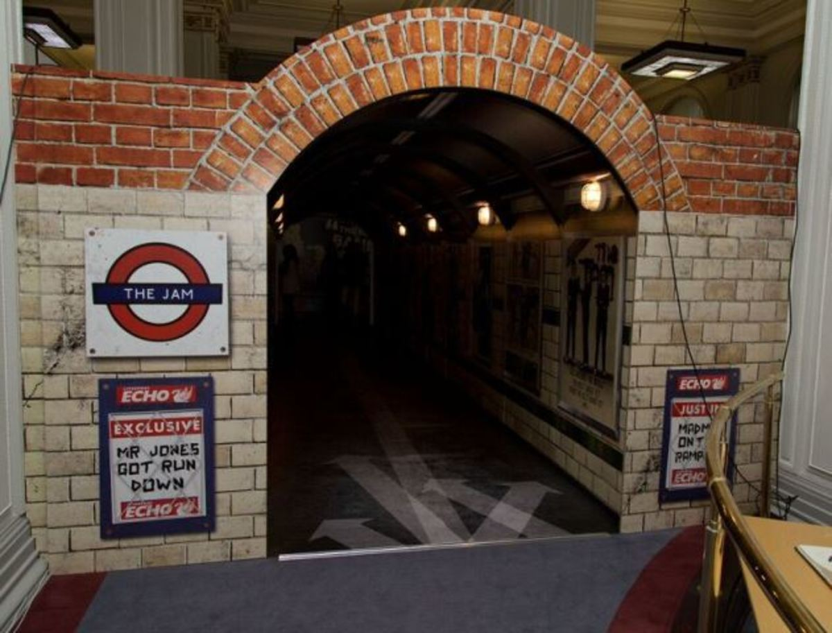The tunnel that leads to the start of the exhibition is patterned after a passenger tunnel from the London Underground and is filled with Jam posters. (Photo by Dean Fardell for Nicetime Productions)