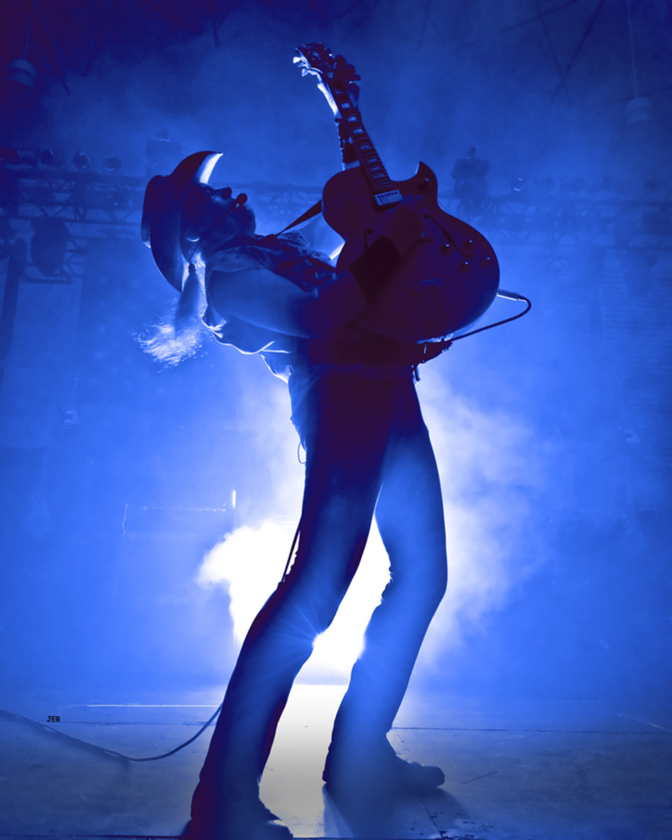 Ted Nugent in blue smoke onstage. Photo by Brown Photography/Courtesy of Ted Nugent.