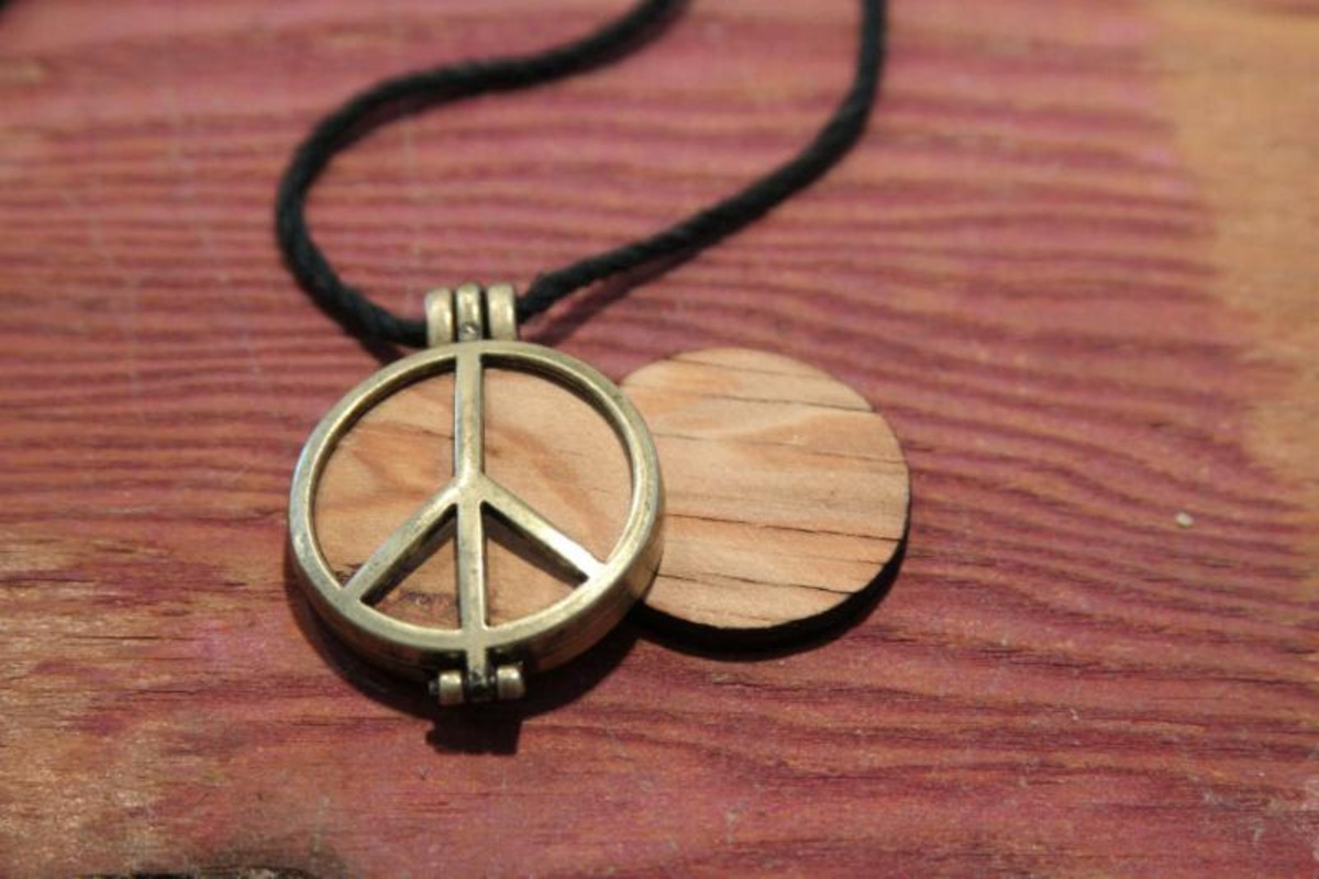 A piece of the Original Woodstock stage fashioned into a necklace.
