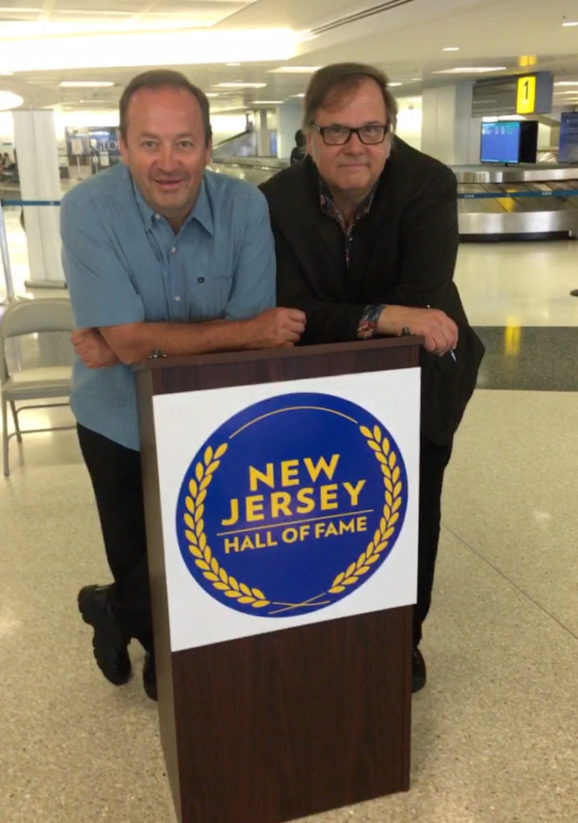 The Smithereens' Jim Babjak (at left) and Dennis Diken are pictured at the announcement of the 2019 inductees to the New Jersey Hall of Fame at Newark Liberty International Airport on June 1, 2019. Photo by Cindy Sivak.