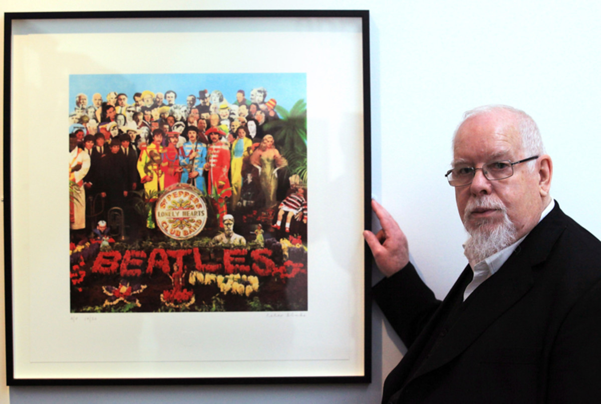 "Artist Peter Blake poses besides a copy of The Beatles' ""Sgt. Pepper"" album cover that he designed in 1967, as he reopened the Holburne Museum on May 12, 2011 in Bath, England. The museum's first exhibition, ""Peter Blake: A Museum for Myself,"" had displayed objects from Blake's own collection together with a number of important works by the artist himself. (Photo by Matt Cardy/Getty Images)"