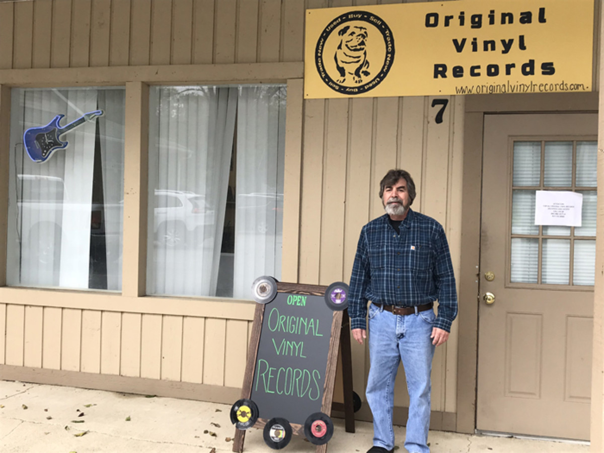 Jim Eigo in front of his record store, Original Vinyl Records.