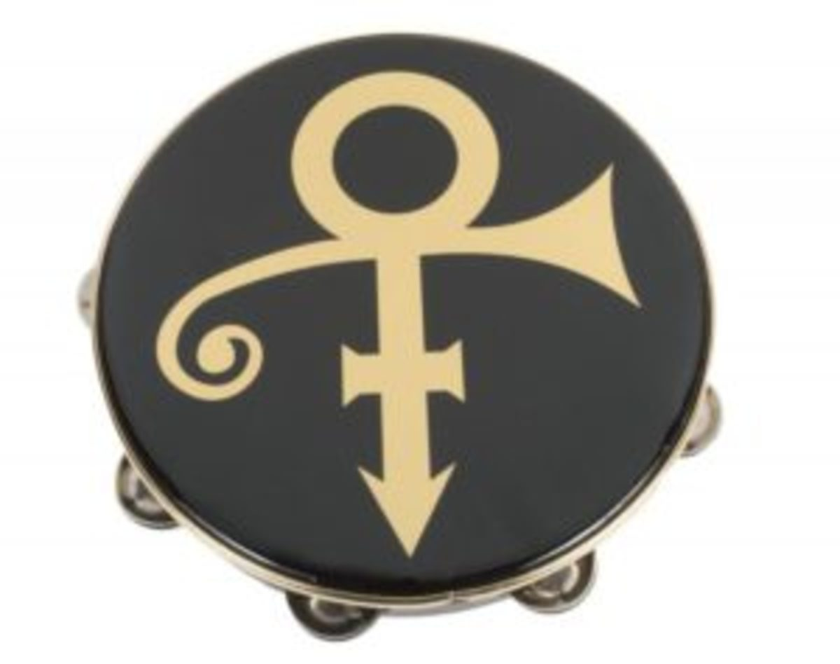 A black Remo tambourine with gold Love Symbol, left by Prince at the home in Marbella, Spain, that he shared with his former wife Mayte Garcia. Accompanied by a letter of authenticity signed by Garcia stating that the tambourine was stage used on Prince's Jam of the Year Tour. Diameter, 10 1/4 inches
