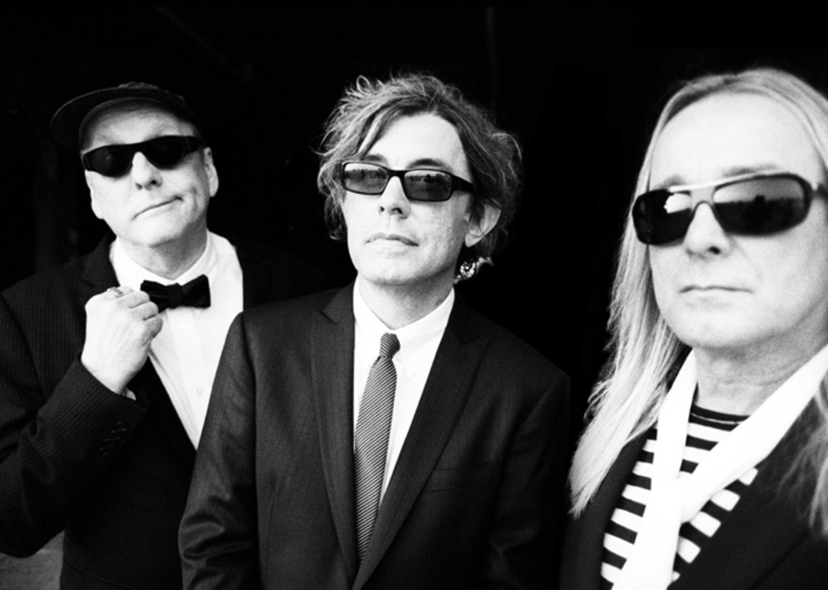 "Cheap Trick — (L-R) Rick Nielsen, Tom Petersson and Robin Zander — just came out with the new studio album, ""Bang Zoom Crazy... Hello"" (above, right), and will promote it on their upcoming ""Rock Hall Three For All"" tour with Heart and Joan Jett & the Blackhearts. (Publicity photo courtesy of Big Hassle Media)"