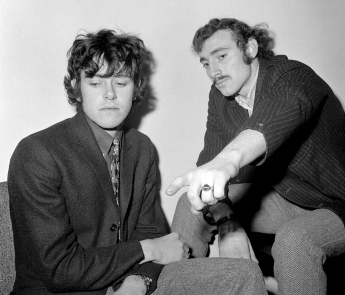 """Nineteen Sixty something, London,"" says Donovan of the photo above. ""My best friend Gypsy Dave and I are road warriors from even before FAME. In some Media office somewhere, Gyp is pointing to my coffee, if I care to drink some that early morning. It's obvious that we have not just had a spliff."" (Photo courtesy of Donovan)"