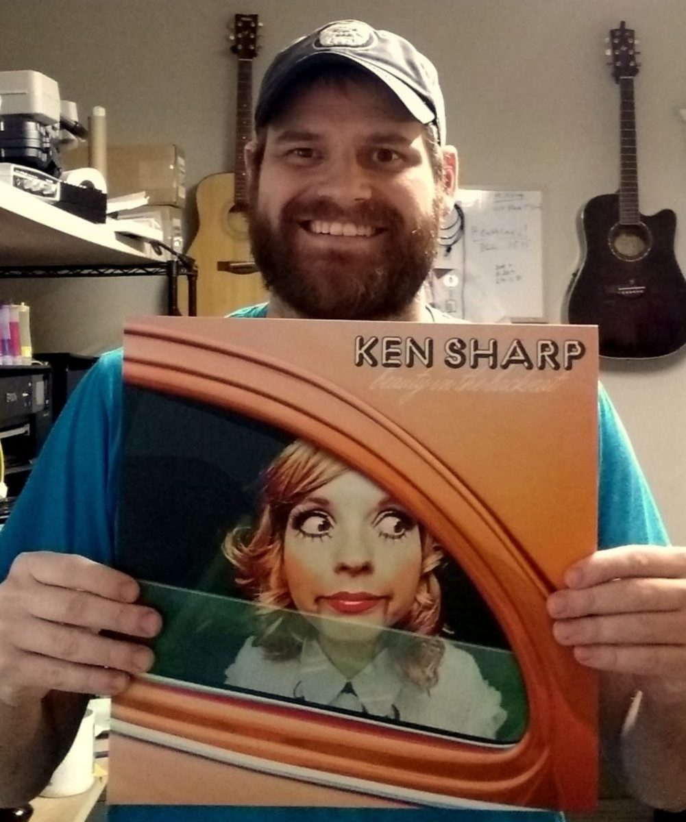 Rob Courtney, owner of Little Elephant Lathe, with Ken Sharp's latest album, 'Beauty in the Backseat.'