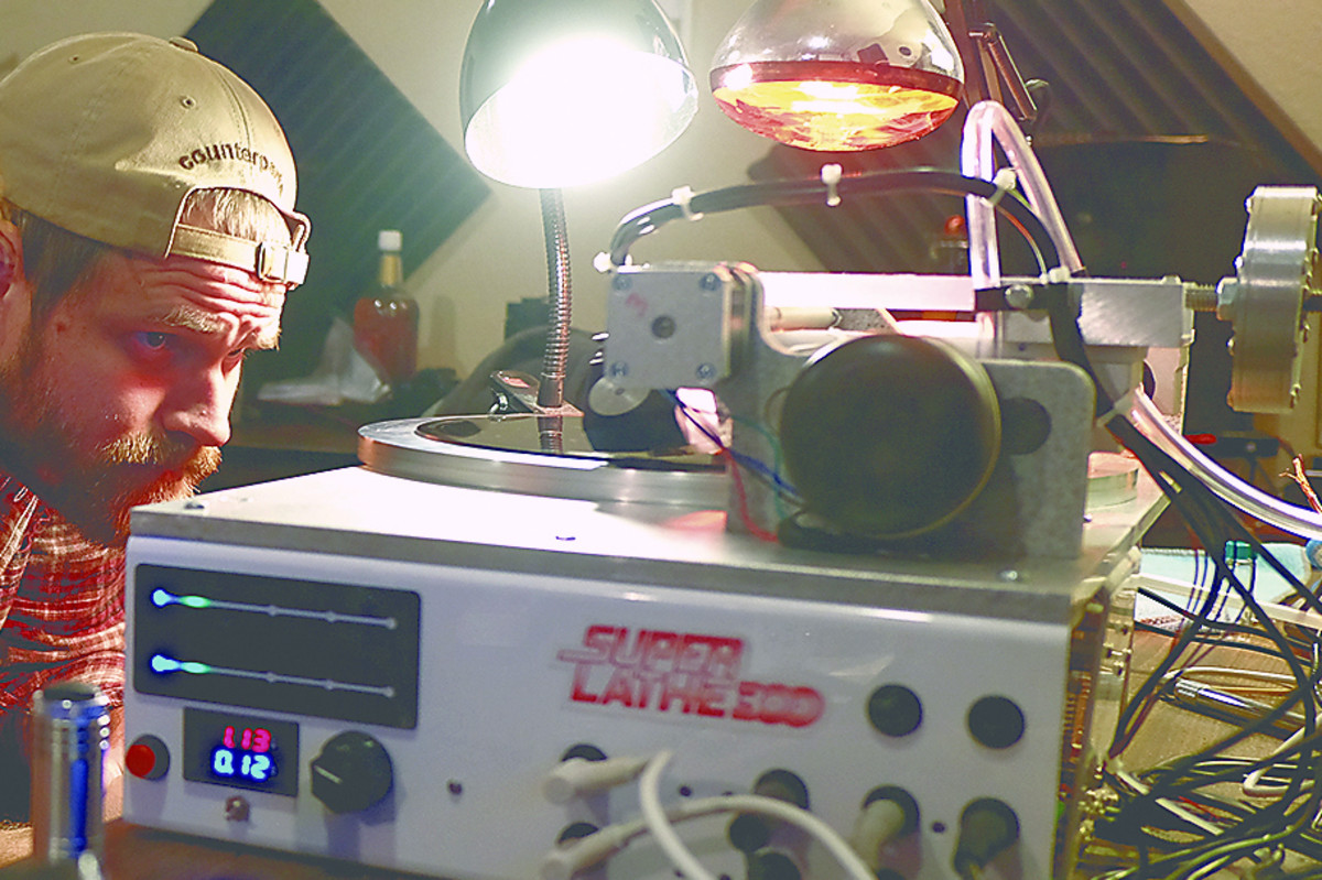 Brian Gross-Bias of Little Elephant Recording watches a vinyl record being cut Wednesday, November 16, 2016 in Toledo, Ohio.