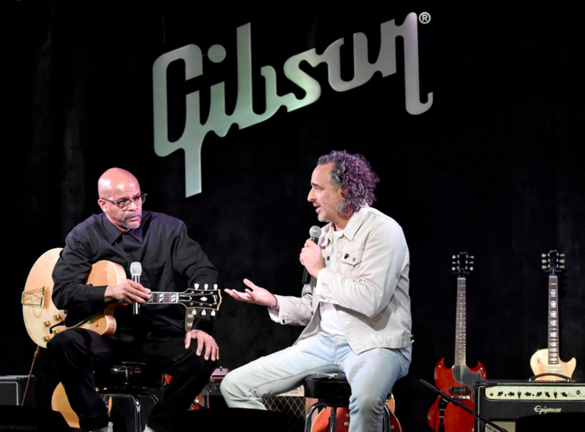 Gibson Brands CEO James Curleigh (right) speaks with Charles Berry Jr., who's holding the company's new Chuck Berry 1955 ES 350T model guitar. (Photo by Chris M. Junior)