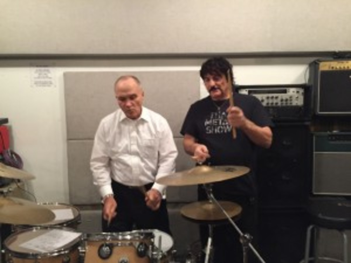 Former NYC Police Commissioner gets drum lessons from Carmine Appice. Photo courtesy of Carmine Appice.