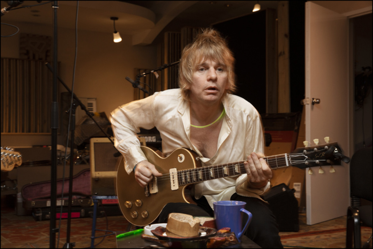 Zak Starkey in the studio with his guitar. Photo by Jill Furmanovsky.