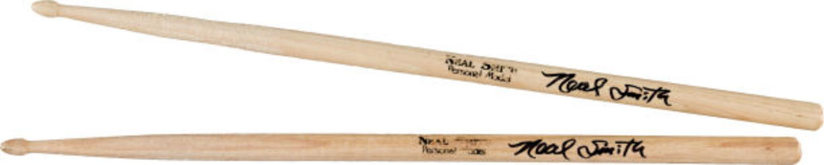 "A pair of Neal Smith Personal Model drumsticks, autographed in black felt-tip, and played in the studio during his recording sessions in May 2014, for the all-star self-titled ""Hollywood Vampires"" album! This lot also includes a CD copy of ""Hollywood Vampires,"" signed by Smith. Sticks in studio-played condition. Photo courtesy of Heritage Auctions."