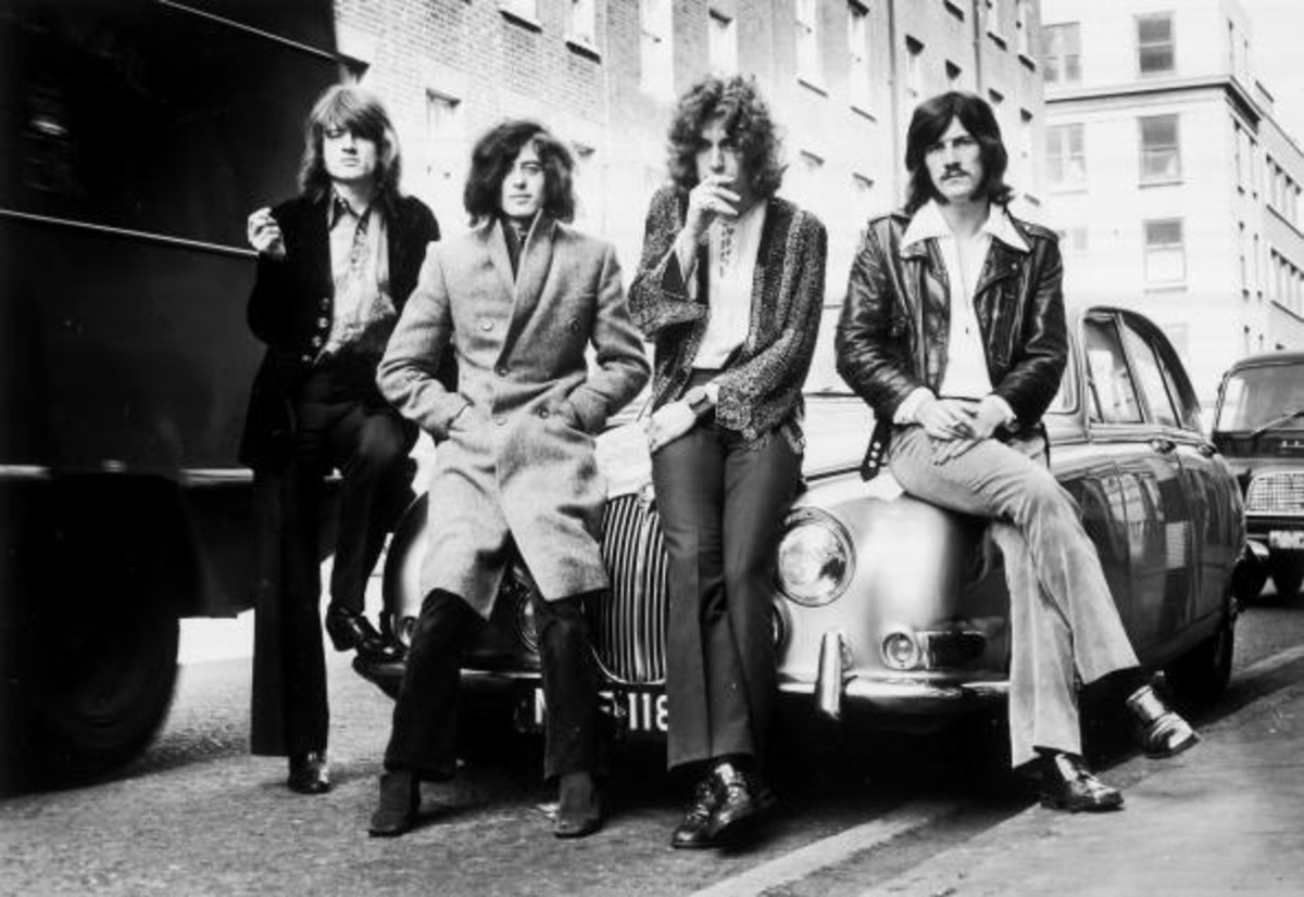 Led Zeppelin's first photo session with WEA Records posed on a Jaguar car in a London street in December 1968. Photo by Dick Barnatt/Redferns
