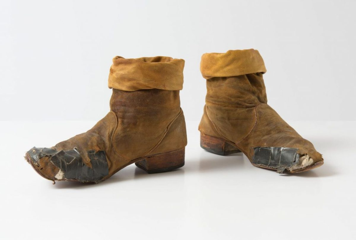 "A battered pair of Keith Richards boots, now on display in Philadelphia as part of the ""Bill Graham and the Rock & Roll Revolution"" exhibit. (Photo courtesy of the National Museum of American Jewish History)"