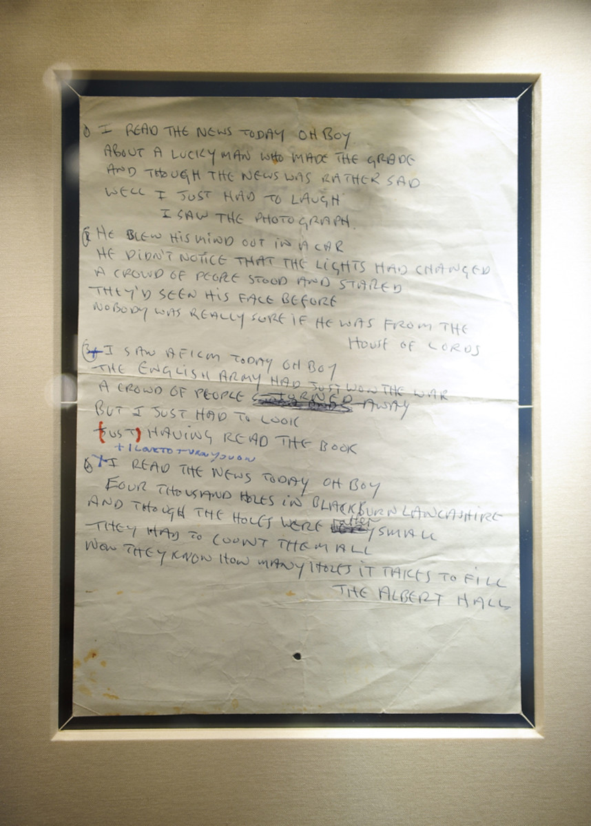 "John Lennon's lyrics for ""A Day In The Life."" The double-sided sheet of paper in Lennon's hand is complete with cross-outs, corrections, reworkings and chronicles the evolution from conception to the lyrics presumably used in the recording studio. The lyrics sold by Sotheby's in 2010 for $1,202,500 to a private American collector. (Photo by Emmanuel Dunand/AFP/Getty Images)"