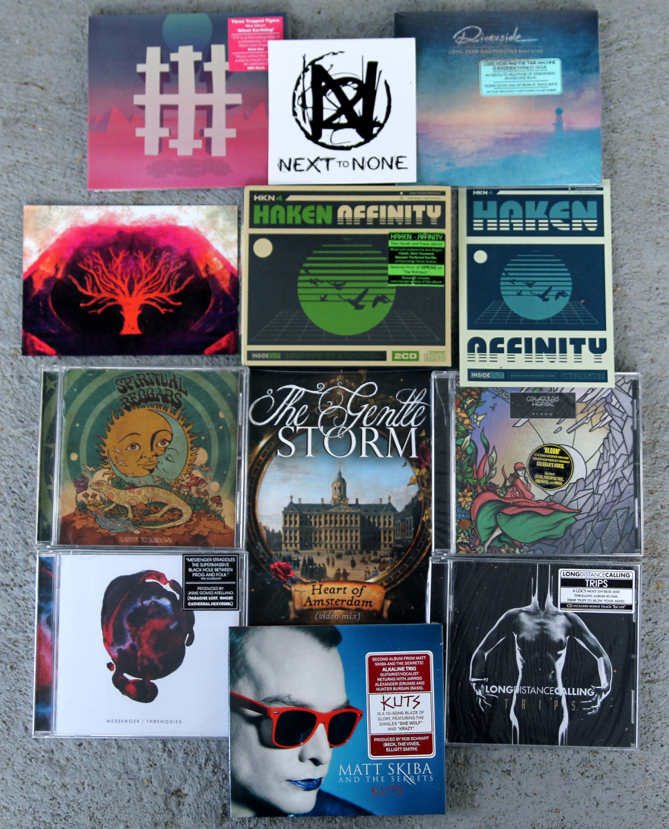 "Giveaway of 7"" vinyl from The Gentle Storm; CDs from Haken, Three Trapped Tigers, Riverside, Spiritual Beggars, Caligula's Horse, Messenger, Matt Skiba and the Sekrets and Long Distance Calling; postcards Haken and Messenger (autographed); and Next to None logo sticker."