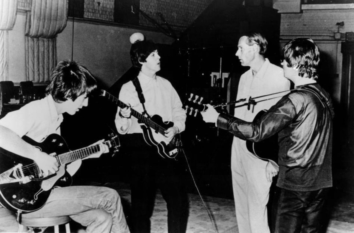 Publicity photo of the Beatles with producer George Martin in the studio at Abbey Road. Only John Lennon, George Harrison and Paul McCartney are pictured.