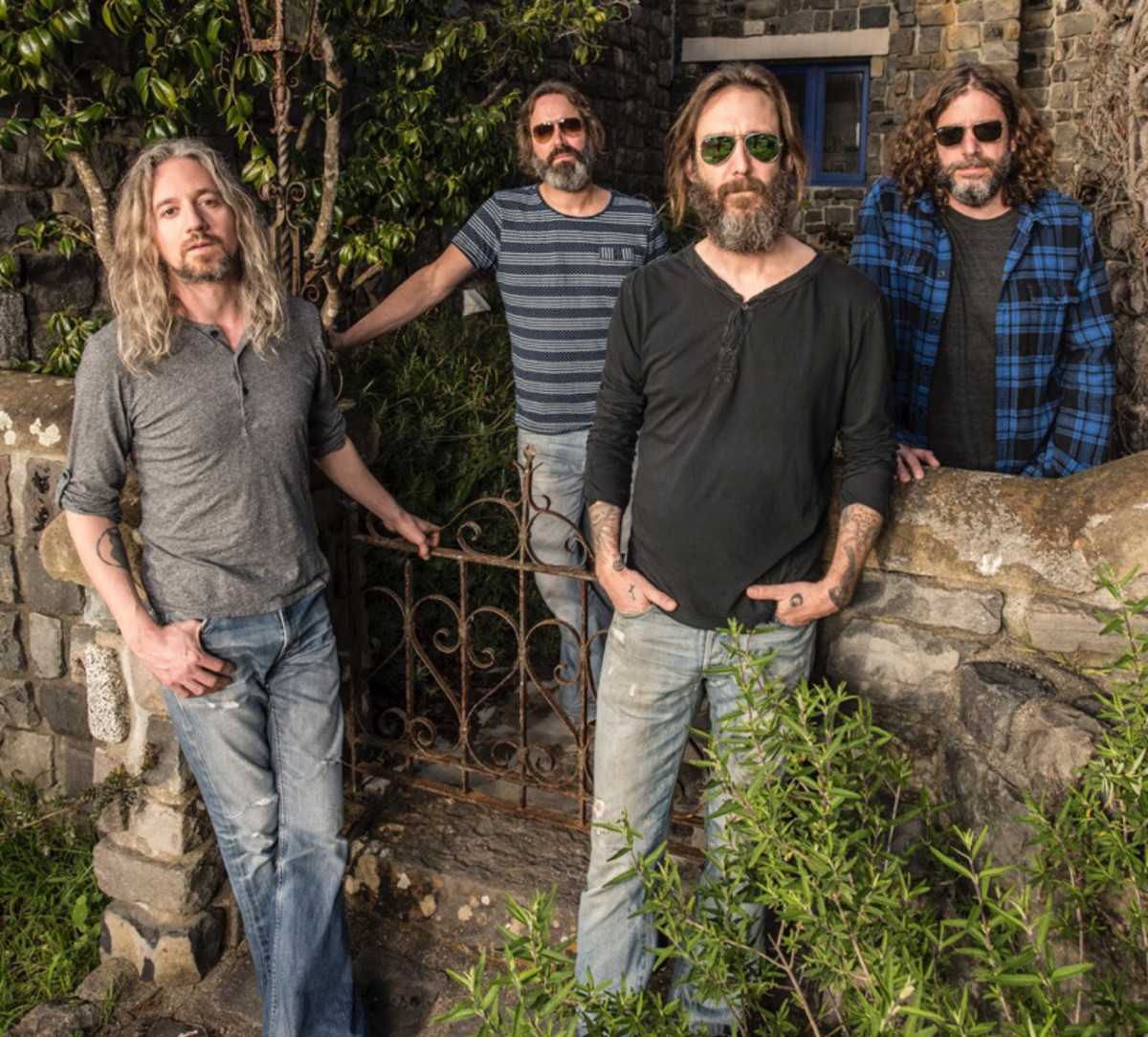 """Chris Robinson (middle) leads his Brotherhood (L-R: Adam MacDougall, Neal Casal and Tony Leone) into a vibrant new release, """"Anyway You Love, We Know How You Feel"""" (above right), and an ongoing tour through 2016. Photo by Jay Blakesberg."""