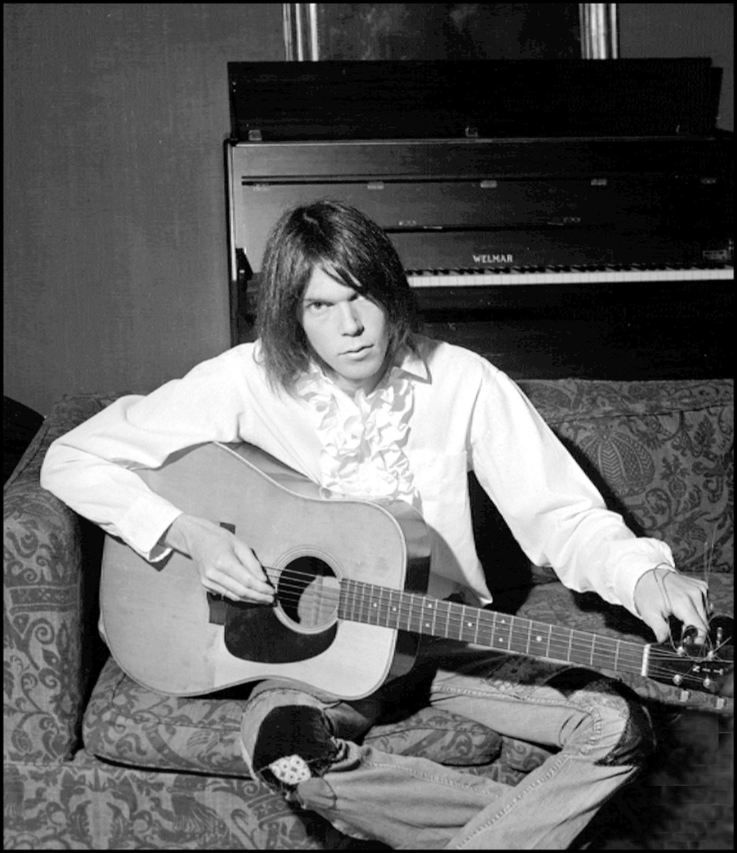 Neil Young with acoustic. (Photo by Dick Barnatt/Redferns)