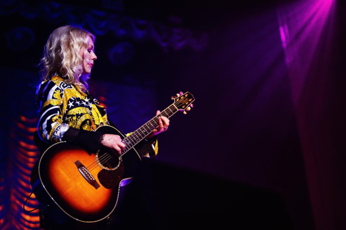 Nancy on guitar. Publicity photo by Kimberly Adamis.
