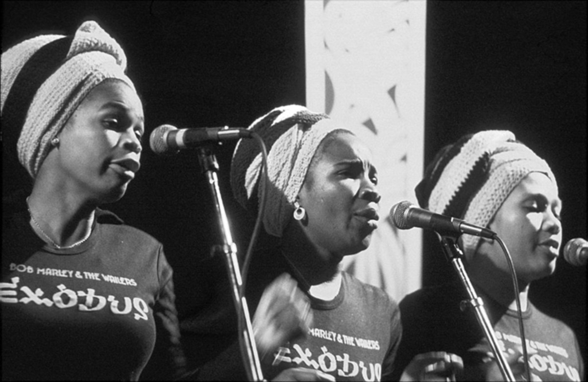 (L-R): Judy Mowatt, Rita Marley and Marcia Griffiths sing backing vocals for Bob Marley & The Wailers in concert at the Rainbow Theatre in London, June 1977. Graham Wiltshire/Hulton Archive/Getty Images