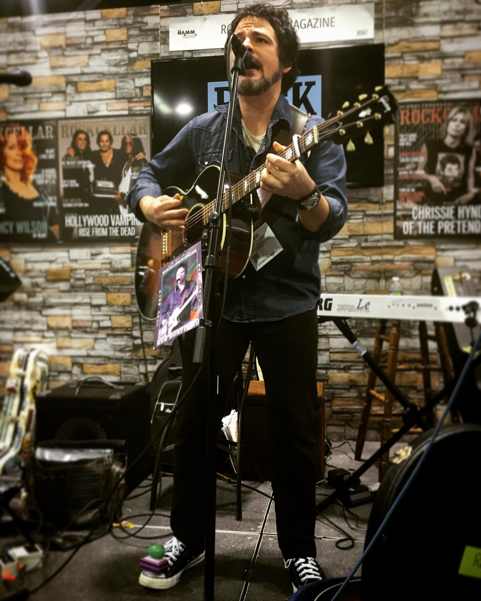 Rob Bonfiglio Performing at the Rock Cellar Booth