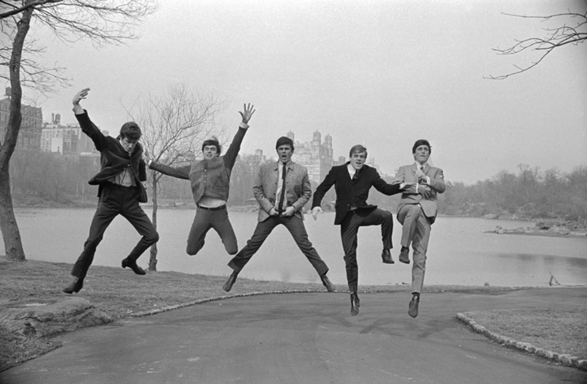 "The origianal caption for this photo at the time of its March 4, 1964 publication in the New York City press read: ""The Dave Clark Five, the latest British rock'n'rollers to visit these shores, demonstrate their joy at the spring-like weather in Central Park in this photograph. The five, who have recently leaped past The Beatles in popularity in their homeland, appear on the Ed Sullivan television show on March 8. The Beatles recently scored stateside triumphs on the show. Left to right are Rick Huxley, Denis Payton, Dave Clark, Lenny Davidson and Mike Smith."" Bettmann / Contributor / Bettmann / Getty Images."