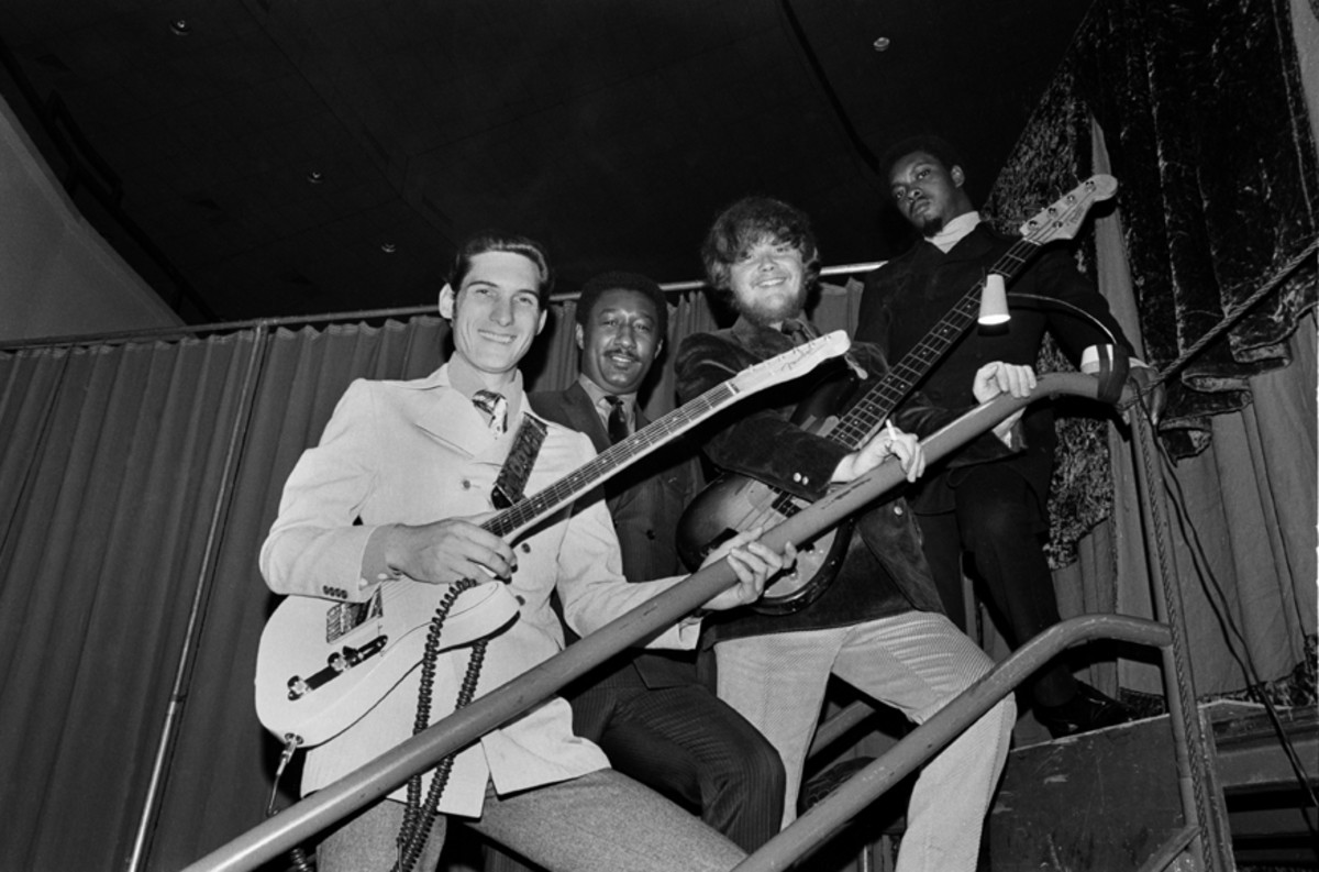 """Booker T. & The M.G.'s, from left to right, Steve Cropper (guitar), Al Jackson Jr. (drums), Donald """"Duck"""" Dunn (bass) and Booker T. Jones pose for a photo on their way to perform in the Stax Records Christmas Concert at the Mid-South Coliseum on December 20, 1968 in Memphis, Tennessee.Don Paulsen/Michael Ochs Archives/Getty Images."""