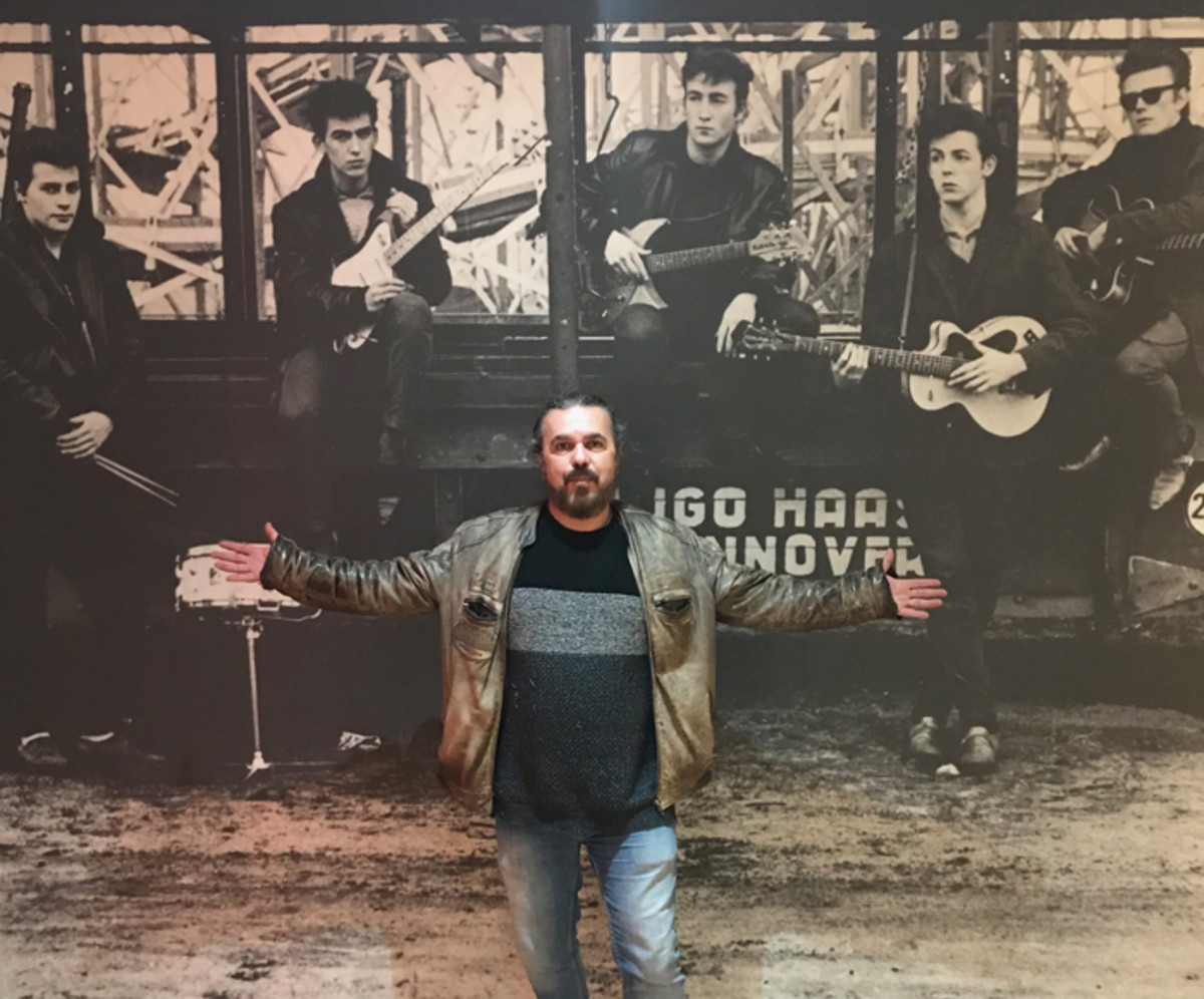 Roag Best, half-brother of The Beatles original drummer Pete Best, poses inside his Magical Beatles Museum in Liverpool. Iimage courtesy of Roag Best.