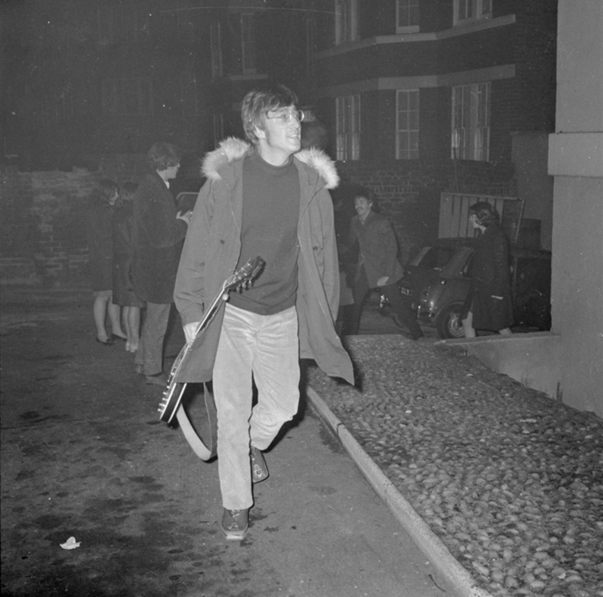 John Lennon arrives at the EMI studios in Abbey Road, London in 1966. (Photo by Larry Ellis/Express/Getty Images)