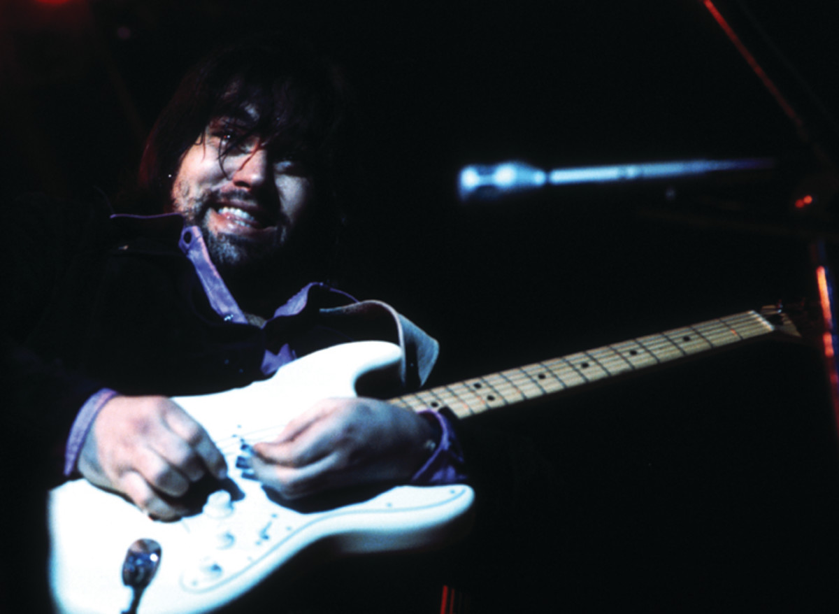 """Singer and guitarist Lowell George of the rock and roll band """"Little Feat"""" performs onstage in July 1974. (Photo by Brian McLaughlin/Michael Ochs Archives/Getty Images)"""