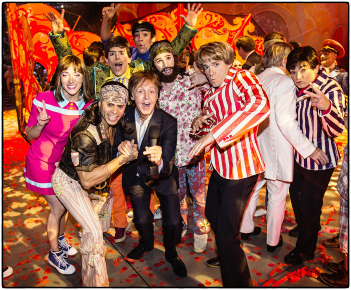 "Sir Paul McCartney with the cast of ""The Beatles LOVE by Cirque du Soleil,"" on July 14, 2016, celebrating the show's 10th anniversary. Photo by MJ Kim."