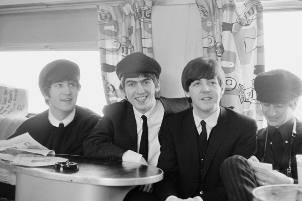 The Beatles posed on a train to Washington during their tour of the U.S. in February 1964.