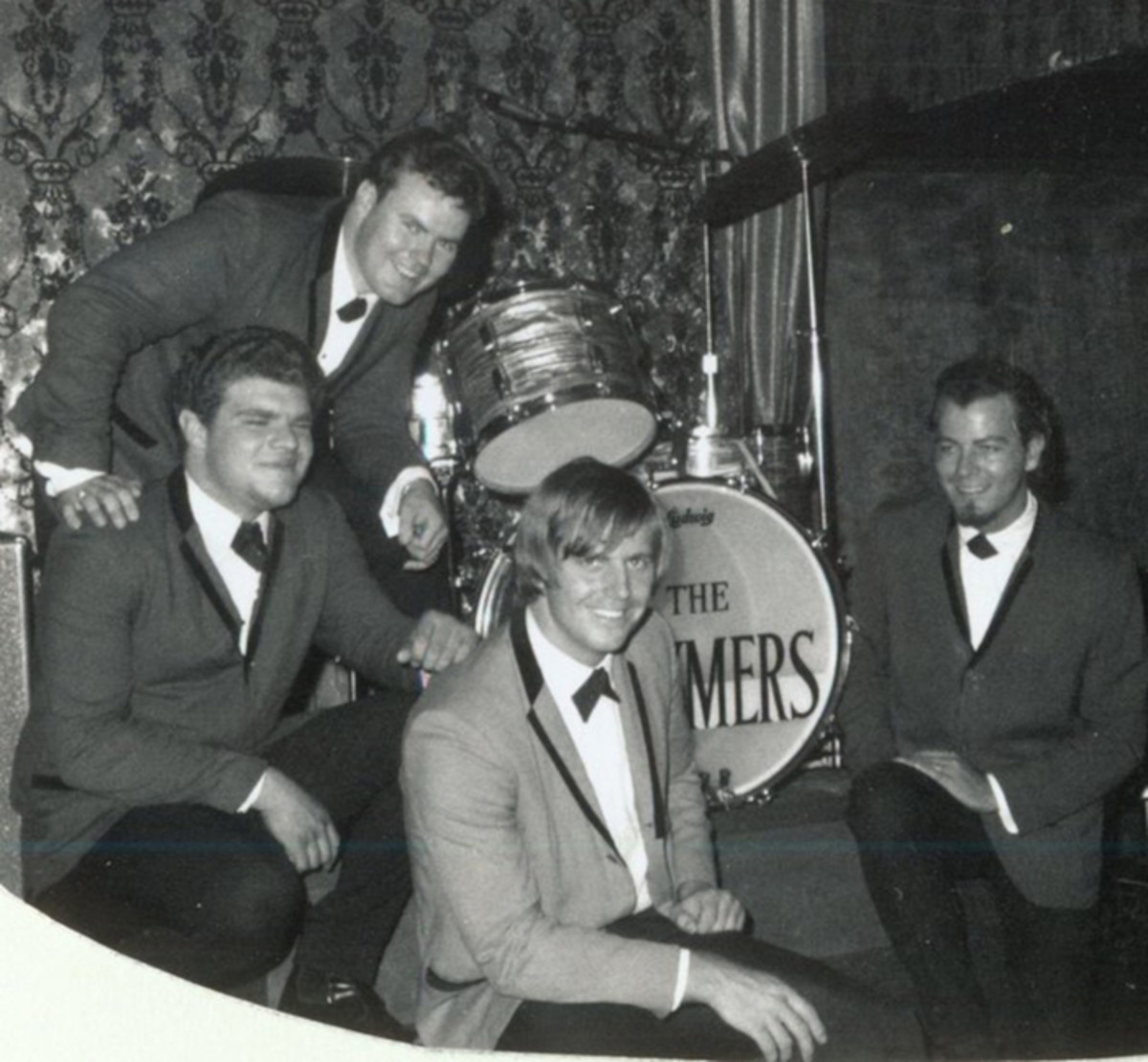 The Brymers (L-R): Kenny Sinner on vocals/keyboards/sax, Jim Mellick on vocals/guitar/harp (standing), Dick Lee on vocals/percussion and Bill Brumley on vocals/bass. Photo courtesy of Dick Lee.