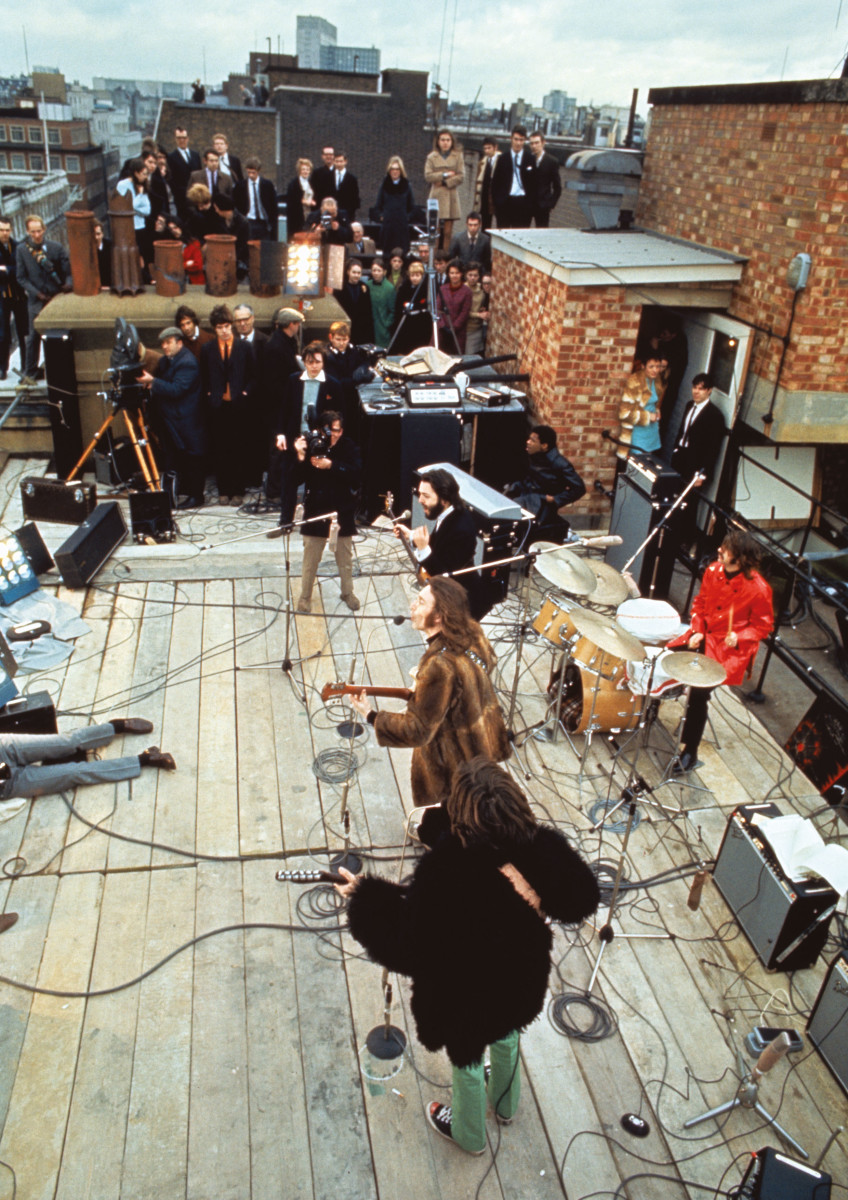 The Beatles perform on the roof of their offices at Savile Row, London, 30th January 1969.Photo by Ethan A. Russell/©Apple Corps Ltd.