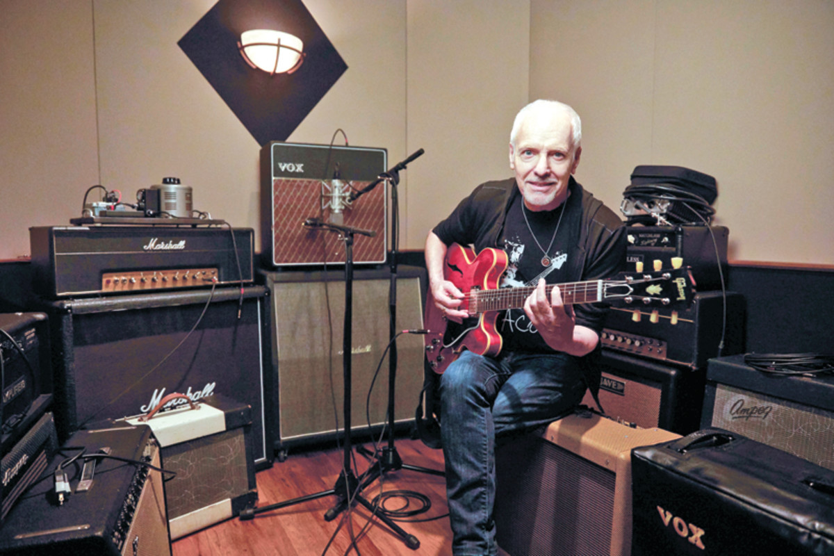Peter Frampton, present day, enjoying the art of writing songs on guitar at his home studio. Publicity photo.