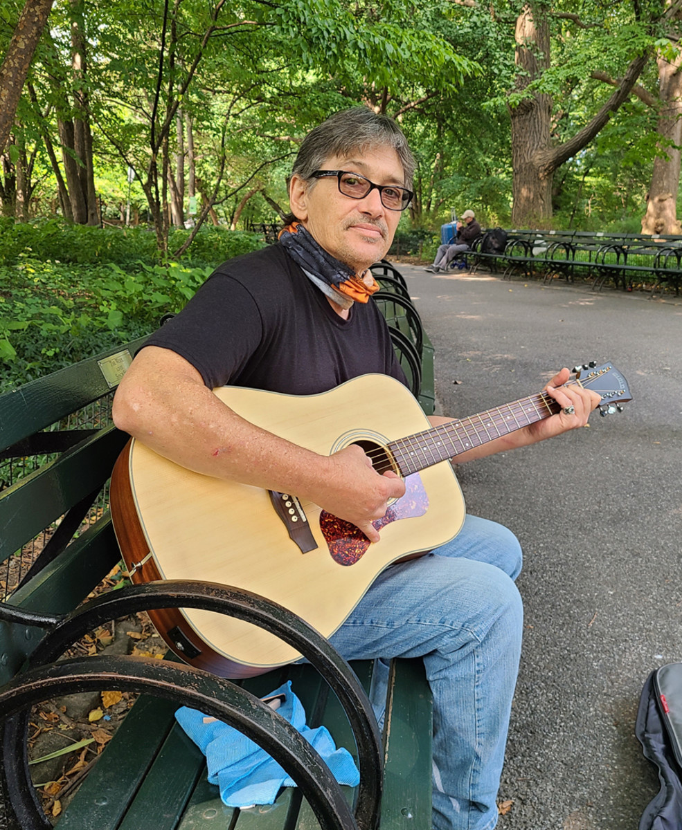 David Muniz performing at the Strawberry Fields memorial. Photo by John French.