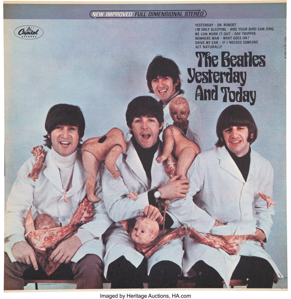 "The BeatlesundefinedYesterday and TodayundefinedFirst State Stereo Butcher Cover Slick Artwork. A First State ""Butcher"" Cover with the ""New Improved Full Dimension Stereo"" label across the top portion. It is a slick with the ""QU LITHO IN US T-2553"" printed in the upper right edge. It was not attached to an album jacket and there is no glue residue on verso. It's a clean and thin sheet with the infamous original Yesterday and Today album cover. In EX-7 condition with toning along the top edge. COA from Heritage Auctions."