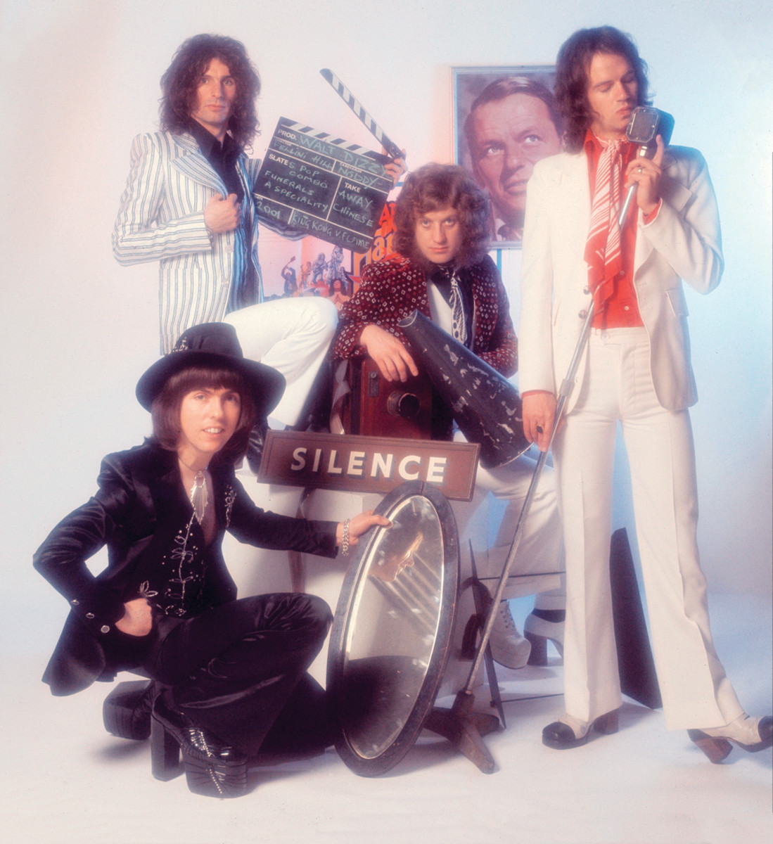 Slade, group portrait, London, 1975, (clockwise from bottom left) Dave Hill, Don Powell, Noddy Holder and Jim Lea.Michael Putland/Getty Images