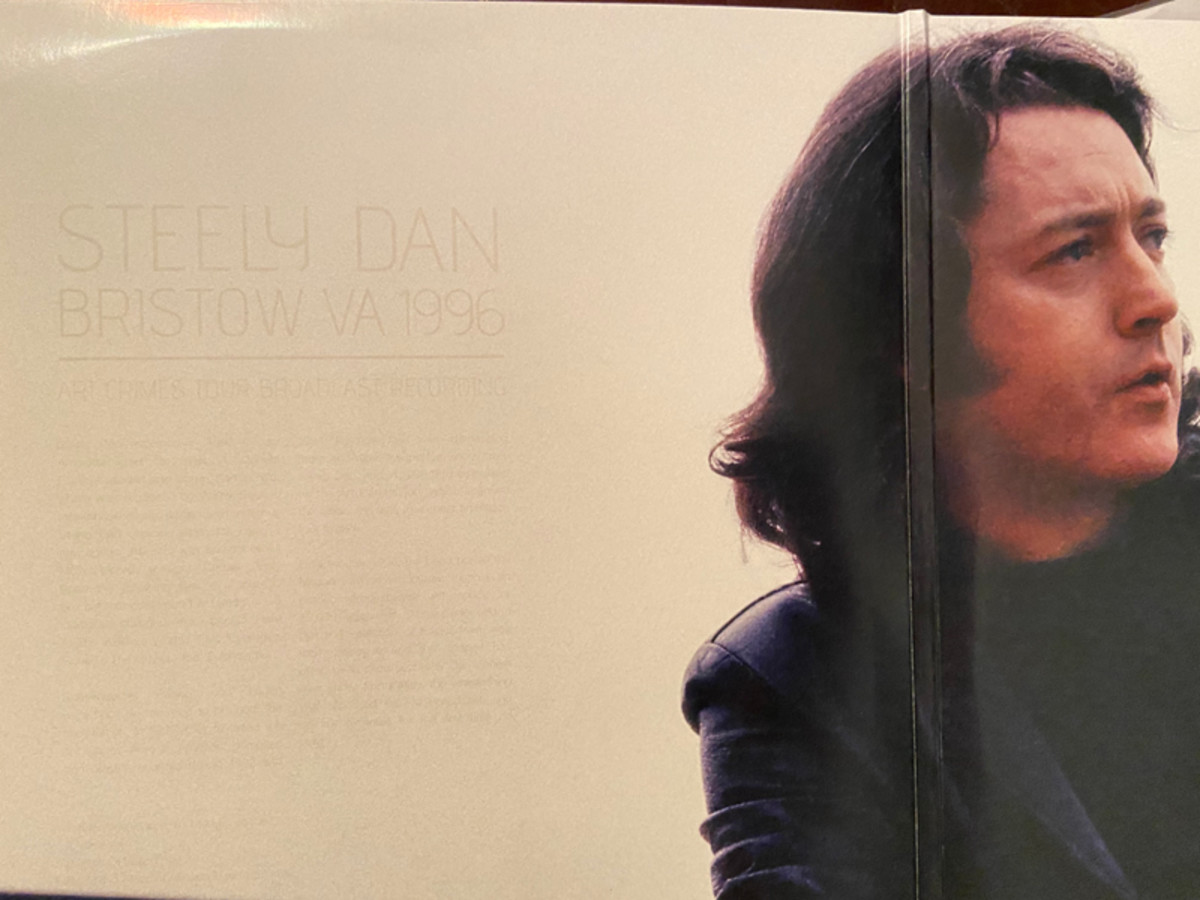 Picture of Rory Gallagher but to the left is the album imprint information for Steely Dan's 2018 release
